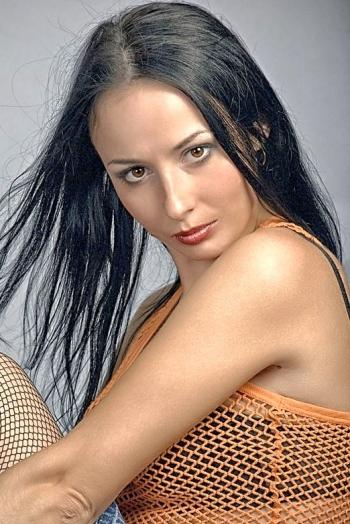 Ukrainian girl Marina,35 years old with brown eyes and black hair.