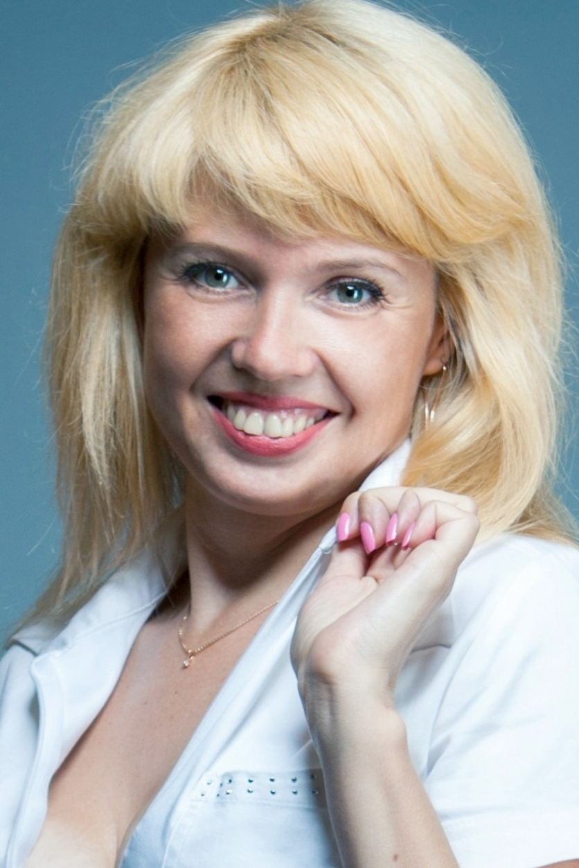 Ukrainian girl Inna,40 years old with grey eyes and blonde hair.