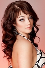 Ukrainian girl Anna,24 years old with blue eyes and dark brown hair.