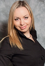 Ukrainian girl Albina,34 years old with brown eyes and blonde hair.