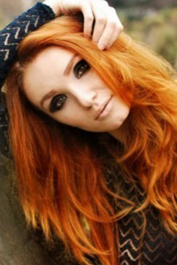 Ukrainian girl Anna,29 years old with green eyes and red hair.