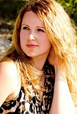 Ukrainian girl Anna,31 years old with green eyes and light brown hair.