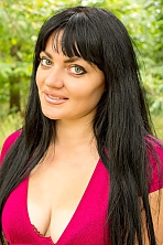 Ukrainian girl Anna,29 years old with blue eyes and black hair.