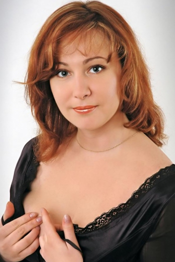 Ukrainian girl Irina,44 years old with grey eyes and red hair.