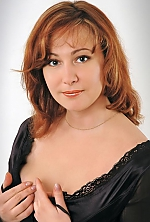 Ukrainian girl Irina,45 years old with grey eyes and red hair.