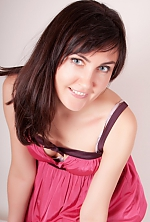 Ukrainian girl Olga,37 years old with blue eyes and black hair.