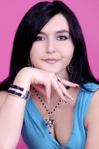 Ukrainian girl Valeriya,30 years old with brown eyes and black hair.