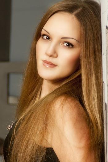 Ukrainian girl Anastasia,33 years old with brown eyes and light brown hair.