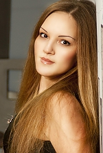 Ukrainian girl Anastasia,31 years old with brown eyes and light brown hair.