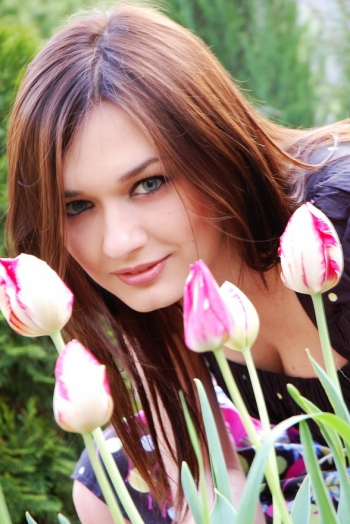 Ukrainian girl Julia,30 years old with grey eyes and dark brown hair.