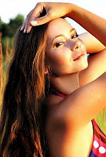 Ukrainian girl Anna,30 years old with grey eyes and light brown hair.