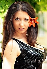 Ukrainian girl Anastasiya,31 years old with green eyes and dark brown hair.