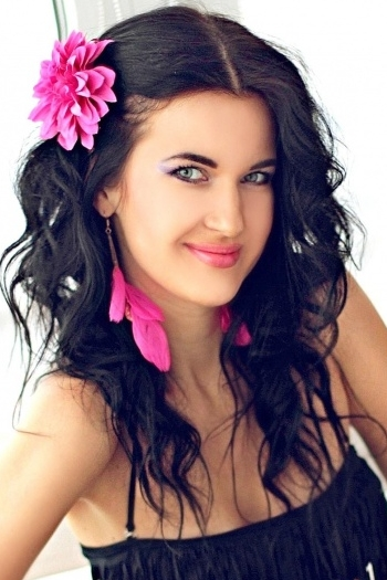 Ukrainian girl Anastasia,30 years old with green eyes and black hair.