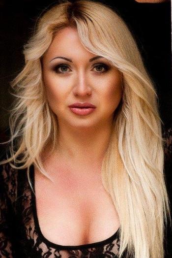 Ukrainian girl Mariya,31 years old with blue eyes and blonde hair.