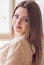 Ukrainian girl Anastasia,23 years old with blue eyes and light brown hair.