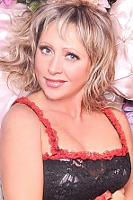 Ukrainian girl Larisa,45 years old with blue eyes and blonde hair.