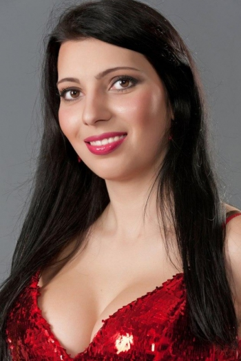 Ukrainian girl Marina,31 years old with brown eyes and black hair.