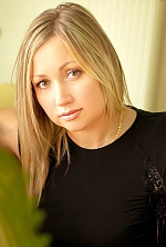 Ukrainian girl Oksana,42 years old with brown eyes and light brown hair.