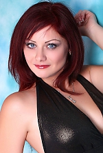 Ukrainian girl Irina,39 years old with blue eyes and dark brown hair.