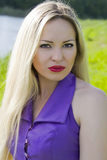 Ukrainian girl Nataliya,35 years old with grey eyes and blonde hair.