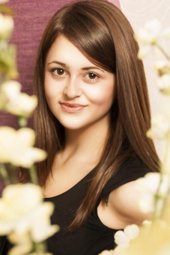 Ukrainian girl Tatyana,25 years old with green eyes and dark brown hair.