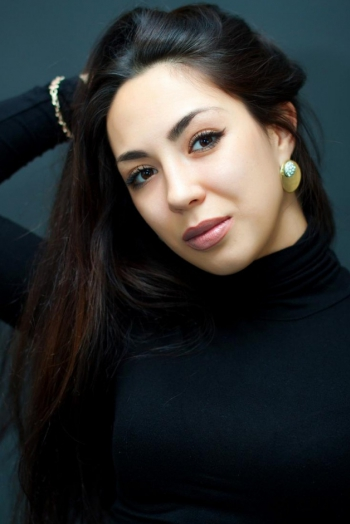 Ukrainian girl Julia,28 years old with hazel eyes and dark brown hair.