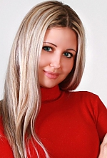 Ukrainian girl Julie,33 years old with blue eyes and blonde hair.
