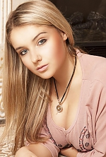 Ukrainian girl  Yulia,31 years old with blue eyes and blonde hair.