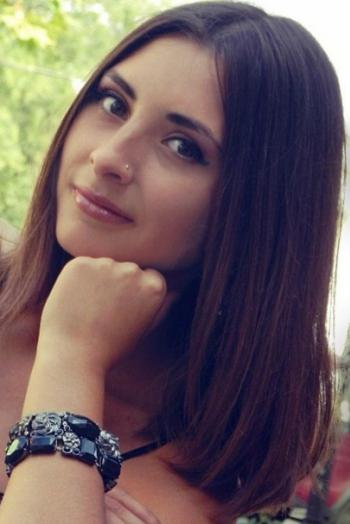 Ukrainian girl Inna,22 years old with brown eyes and dark brown hair.