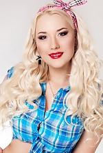 Ukrainian girl Tanya,25 years old with blue eyes and blonde hair.