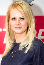 Ukrainian girl Tatiana,35 years old with grey eyes and blonde hair.