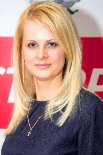 Ukrainian girl Tatiana,34 years old with grey eyes and blonde hair.