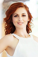 Ukrainian girl Elena,36 years old with brown eyes and dark brown hair.