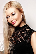 Ukrainian girl Nataliya,37 years old with blue eyes and blonde hair.