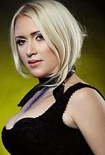 Ukrainian girl Olga,38 years old with grey eyes and blonde hair.