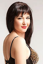Ukrainian girl Tatiana,38 years old with brown eyes and dark brown hair.