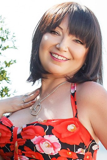 Ukrainian girl Anna,51 years old with green eyes and dark brown hair.
