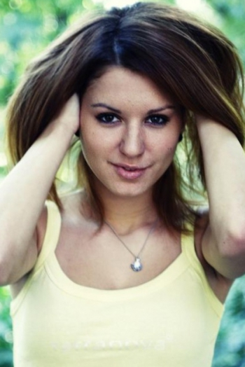 Ukrainian girl Diana,25 years old with brown eyes and red hair.