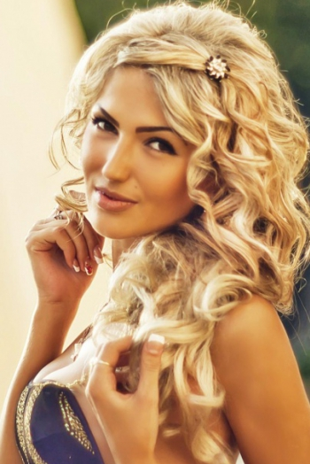 Ukrainian girl Julia,26 years old with hazel eyes and blonde hair.