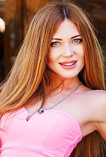 Ukrainian girl Kristina,30 years old with green eyes and light brown hair.