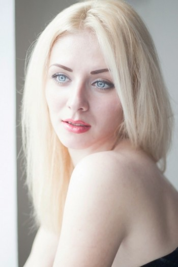 girl Tatjana, years old with  eyes and  hair.