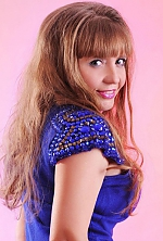 Ukrainian girl Olga,43 years old with grey eyes and light brown hair.