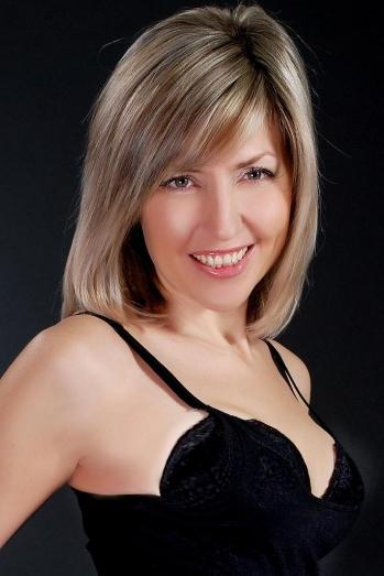 Ukrainian girl Irina,47 years old with  eyes and  hair.