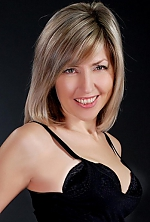 Ukrainian girl Irina,46 years old with green eyes and blonde hair.