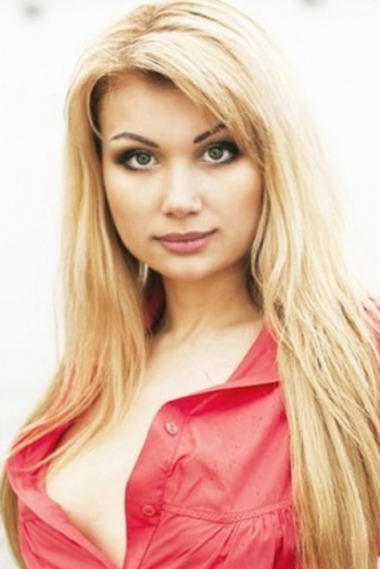 Ukrainian girl Mariya,29 years old with green eyes and blonde hair.