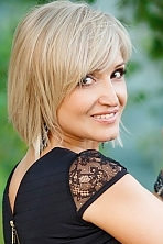 Ukrainian girl Larisa,52 years old with hazel eyes and blonde hair.