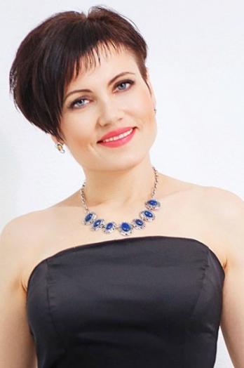 Ukrainian girl Alexandra,40 years old with grey eyes and dark brown hair.