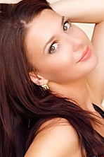 Ukrainian girl Ekaterina,25 years old with hazel eyes and dark brown hair.