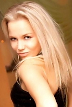 Ukrainian girl Valya,34 years old with blue eyes and blonde hair.