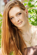 Ukrainian girl Karina,25 years old with green eyes and red hair.
